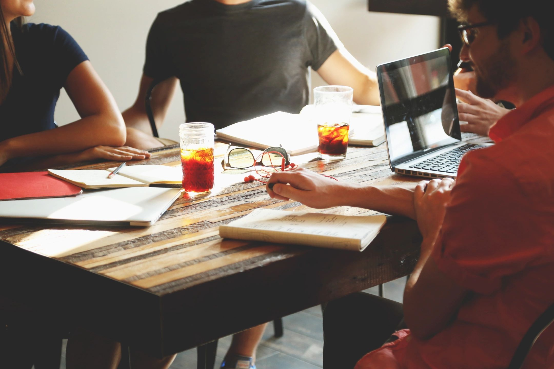 photo of people meeting around table